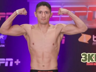Giovani Santillan flexes at weigh-in for Angel Ruiz welterweight bout