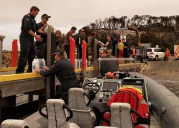 Police unloading water in Mallacoota from one of their smaller vessels photo: Victoria Police