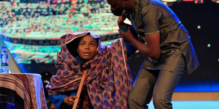 Ofosua mounted the stage as a visually impaired person