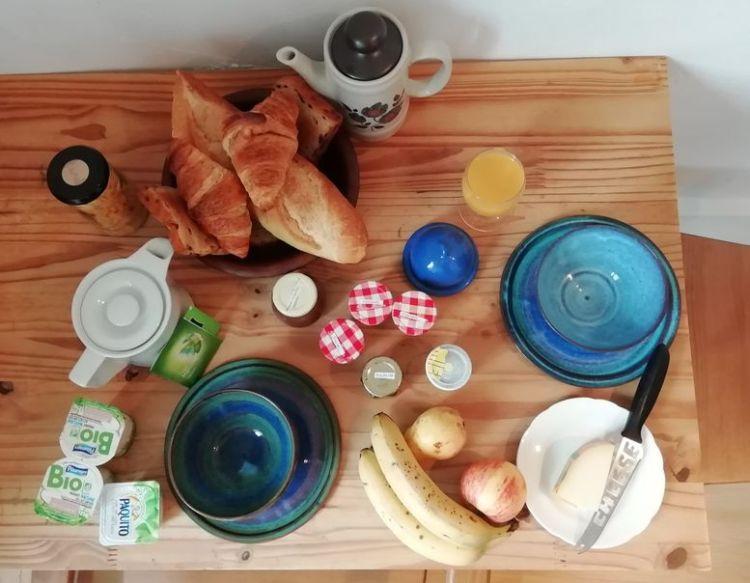 Breakfast - croissants, bread, jam, fruit, cheese yogurt, tea and coffee