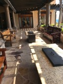 Outdoor seating and fire pit tables outside the bar by the main pool