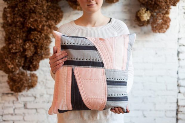 Handmade pillow with hand stitching. Improv quilting