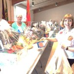 Donna Wilzer (background) Helps Janet Linder arrange Chinese Baskets