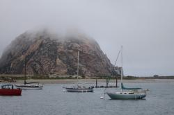 low clouds and boats