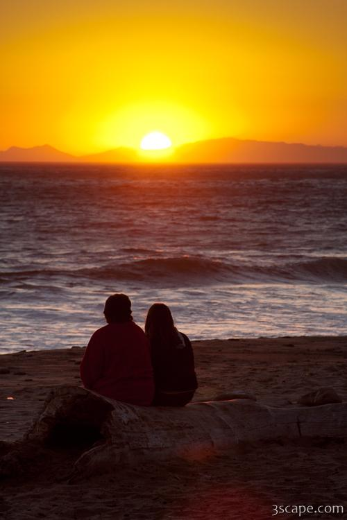 Two people enjoying the sunset at Tree at sunset Leo