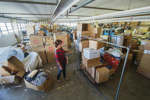 DENNIS ODA / DODA@STARADVERTISER.COM                                 Barbara Yamashita, deputy director of the city Department of Community Services, shows a third-floor room at 431 Kuwili St. in Iwilei that is now used for storage, but is slated to be converted into permanent supportive housing units with running water.