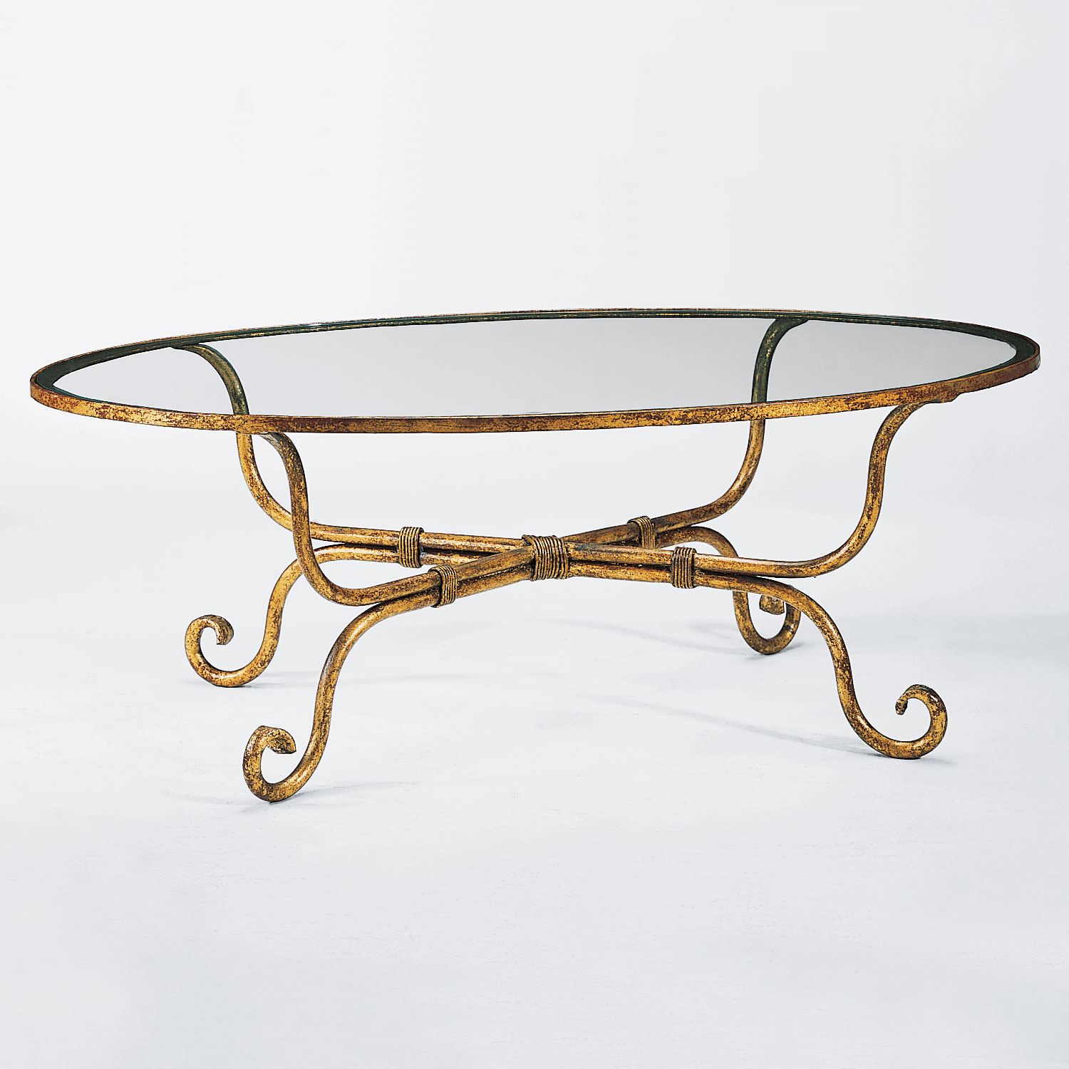 oval coffee table in distressed gold