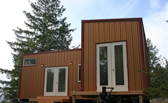 Two Tiny Houses On Wheels Permanently Joined Together To