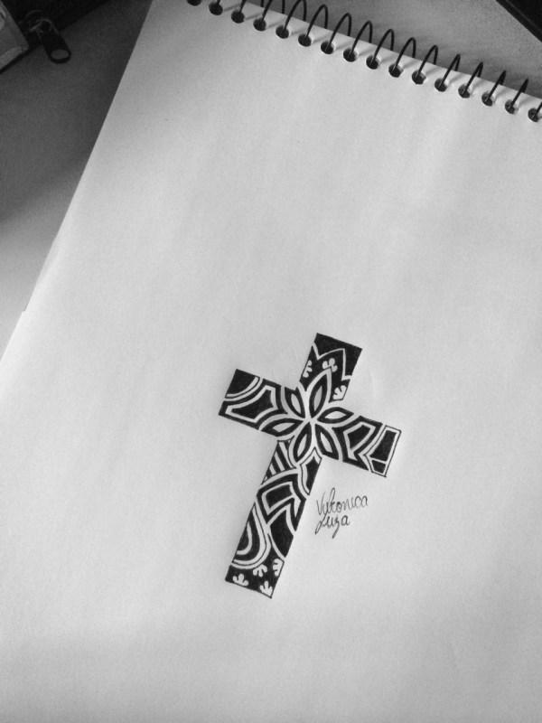 karibenha cross tattoo