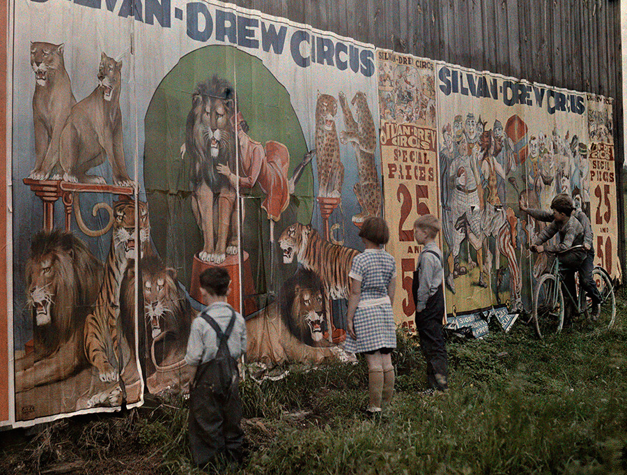 Children read a Sylvan Drew Circus billboard, 1931. Photograph by Jacob J. Gayer, National Geographic Creative