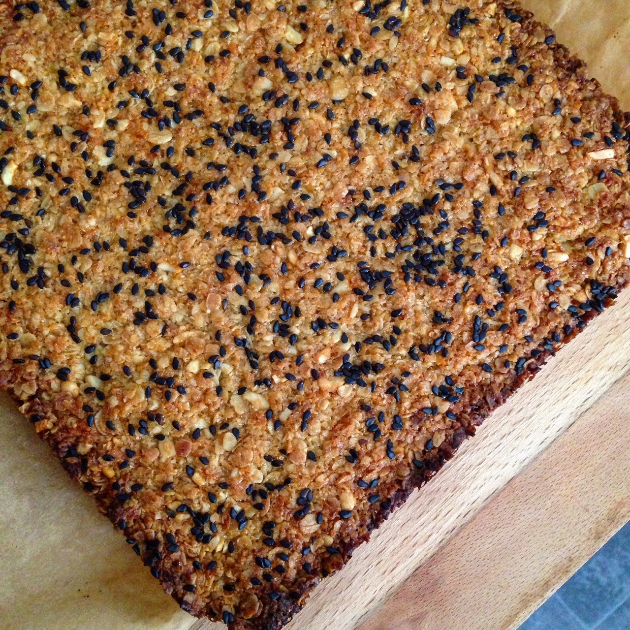 """Simple vegan flapjacks! Weigh out 250g of oats Melt together 3TBSP of Golden Syrup, 150g of soy butter and 125g brown sugar in a saucepan.  Mix both together and press into a lined 9"""" square tin. Bake on gas mark 6 until golden brown all over (15-20 mins) DONE!  Add whatever you want to jazz them up, I've used black sesame seeds and dedicated coconut here!  Don't forget to tag whatleilaeats in your creations!  Love Leila xx"""