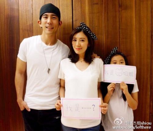 Xiu Jiekai with wife and daughter