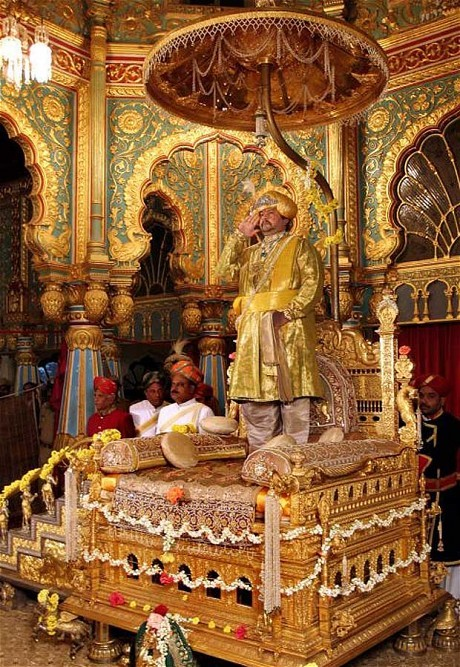 Obit of the Day: Live Like a Maharaja<br /><br /><br /><br /> Srikantadatta Narasimharaja Wadiyar was the son of a maharaja in a line that dated back to 1399 in the southern region of Mysore. Although his father was the last official maharaja, who was grandfathered in after Prime Minister Indira Gandhi eliminated the ubiquitous royal titles in 1971, residents and tourists in the region continued to honor him in the same way.<br /><br /><br /><br /> Mr. Wadiyar oversaw the annual Mylore religious festival which brought thousands of tourists and allowed him to play the role of maharaja, dressed in the all the requisite finery and sitting on a golden throne.<br /><br /><br /><br /> His interests were varied. Mr. Wadiyar served as a member of India's parliament for four terms. He also transformed a family palace into a five-star hotel and is renovating another. Working with his wife, they established the Royal Silks of Myore which sells saris designed by the couple.<br /><br /><br /><br /> Born in 1953, Mr. Wadiyar considered it a special number and as a student of numerology he made sure the four digit number appeared on his license plates and as part of his cell phone number - he had 20 of the former and 15 of the latter.<br /><br /><br /><br /> Srikantadatta Narasimharaja Wadiyar, who had no sons leaving a succession plan in disarray, died on December 10, 2013 at the age of 60.<br /><br /><br /><br /> Sources: Telegraph, International Business Times, and ndtv.com<br /><br /><br /><br /> (Undated image of Srikantadatta Narasimharaja Wadiyar on his throne is copyright of AP and courtesy of the Telegraph)