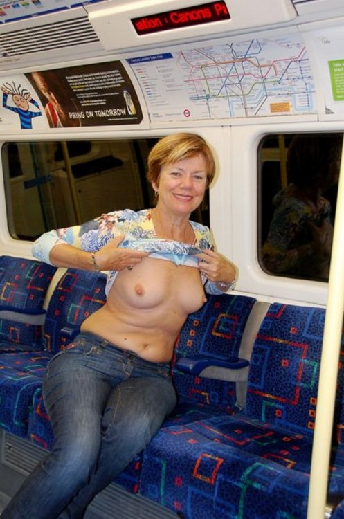 beautifulwives2:  See more beautiful women doing the things they like to do at www.beautifulwives2.tumblr.com. Reblog… Follow… Submit photos… Share…  Mature tit flash. Public, too.