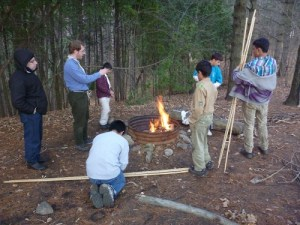 Building a cookfire and a frame for cooking the whole chickens