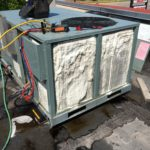 Cleaning an AC condenser coil.