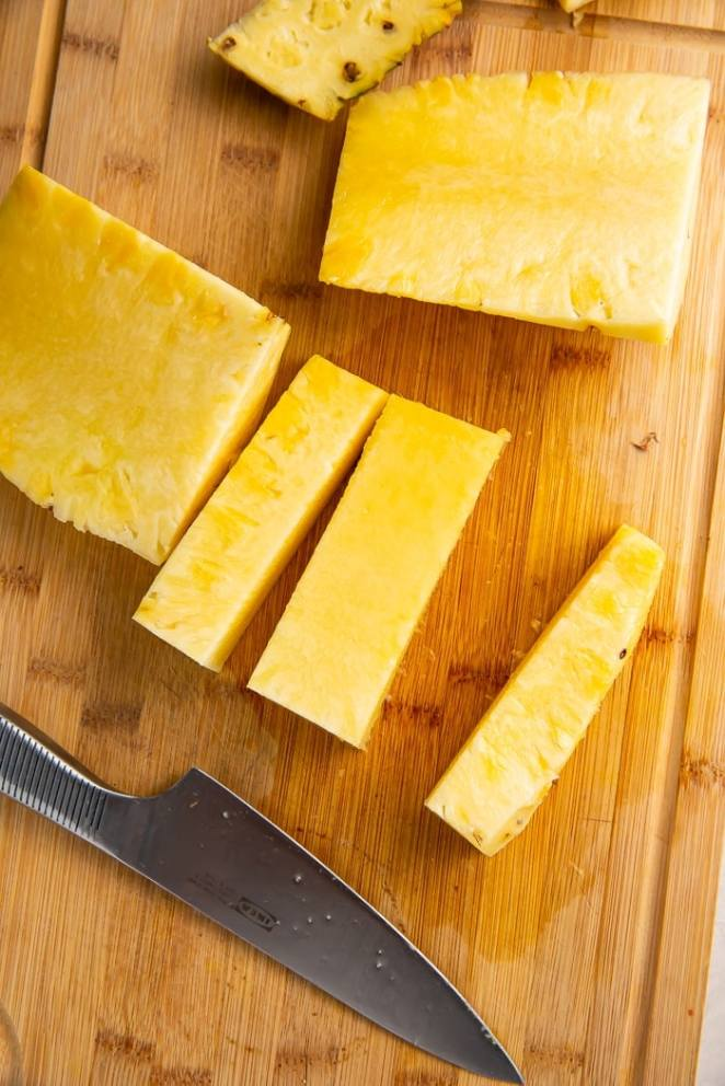 Sides cut away from core of pineapple
