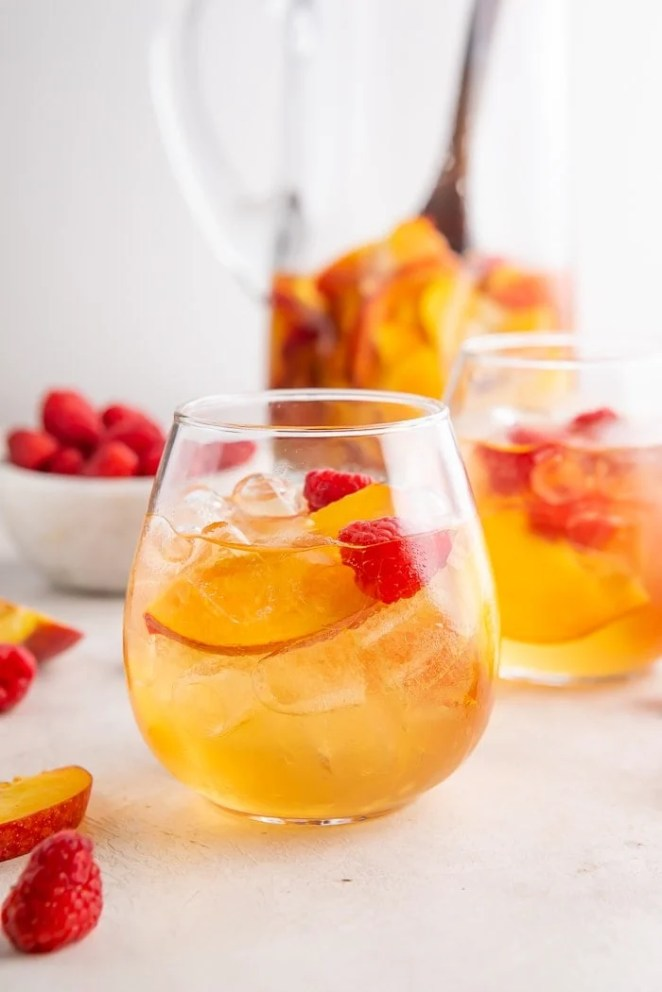 Two glasses of peach white wine sangria