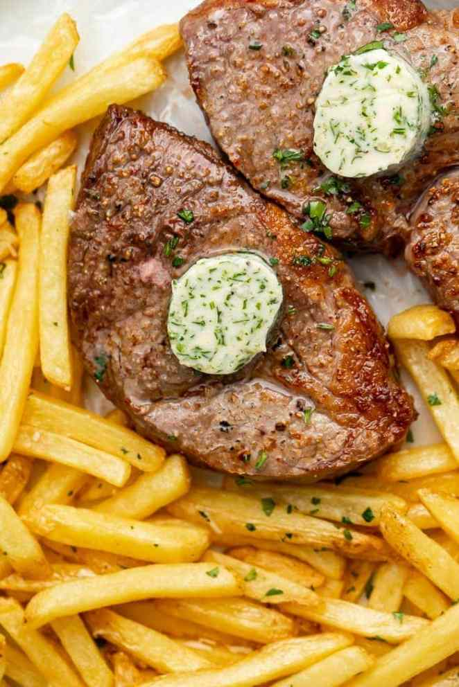 Steak with herb butter and french fries