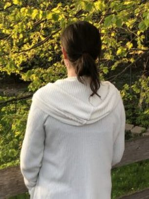 Mariah wearing sweater hood