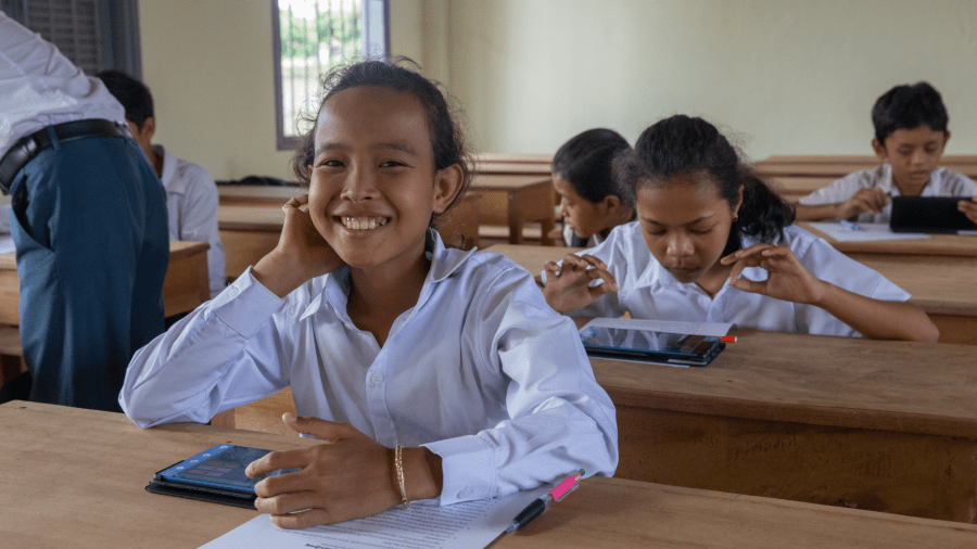 Classroom of children learning English in Cambodia.