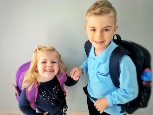 Siblings excited about first day of school.