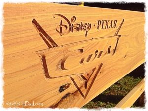 Disney Pixar Cars engraving in a fence plank.