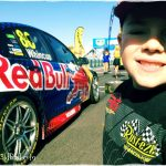 Indy smiles beside the Red Bull Supercar