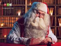 Santa writing at his desk
