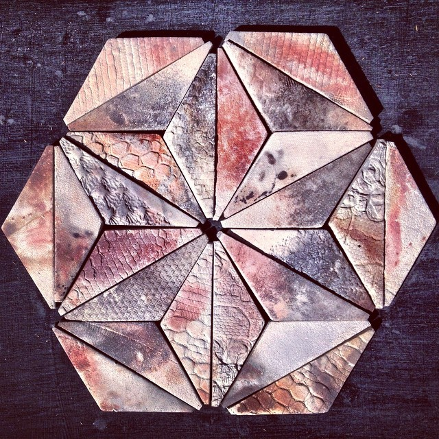 #handmade #bisque #tiles #smoked with various oxides,metal, seaweed and driftwood overnight. Thanks to @dylanpalmermitchell.o for assistance. #unique #art #design #architecture #decor #interiors #interior #stoneware #colours #triangles #hexagon #pattern