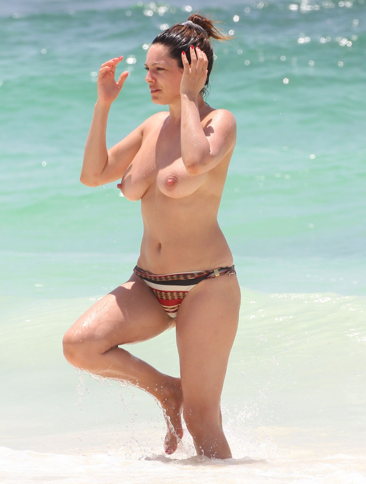 Kelly Brook topless on the beach in Cancun