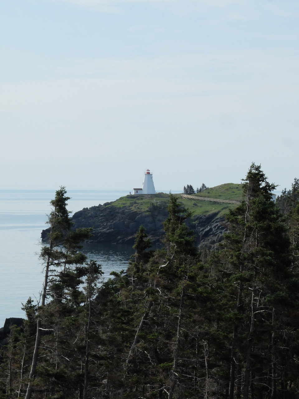 Travels: Grand Manan, New Brunswick. Swallow Tail Lighthouse seen from the Hole in the Wall Trail