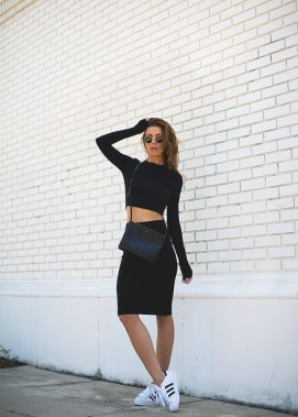 Both easy on the eye and practical. You can't really go wrong with a black co-ord outfit. Via Jennifer GraceBag: Céline, Scuba Top/Skirt: Red 23, Sneakers: Adidas
