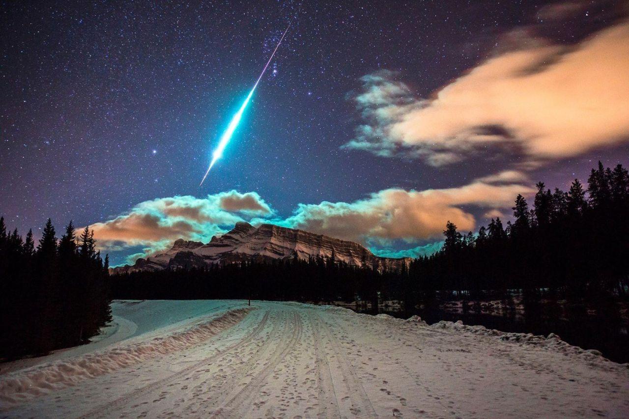 Fireball above Rundle Mountain in Alberta, Canada.  by Brett Abernethy