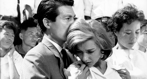 "I remember everything,"" says a disparate female voice, as if in agony. ""You remember nothing,"" a male voice replies to her. He says it again. ""Nothing."" The opening minutes of Alain Resnais' 1959 debut feature Hiroshima, Mon Amour are arguably the most interesting, as they explore the irrevocable damage caused by the atom bomb dropped on Hiroshima during World War II. Bobbing in and out of hospital corridors, museum exhibits, and looking at survivors on the city streets, the themes of this opening ripple throughout the film. It is the film at its most potent and, in a way, most prescient. What is the difference between sympathy and empathy? Where is it useful and where is it dangerous? What is the difference between memory and experience, and memory and third hand witness? Nearly 60 years after Resnais' film, we are living in a fairly interesting age where not only where mass media can cover international and domestic tragedies with immediate turnaround, even on the front lines, as it were. On Twitter, you could follow the events of Ferguson, MO or the events in Middle East, all in front of you in an instant. But the internet has also allowed this illusion of the eye witness account to proliferate exponentially. This has made sympathy and empathy, and the experience of tragedy, blurred and muddled, also making the questioning of those emotions more relevant. […]  - The Awful Truth: Alain Resnais' Hiroshima, Mon Amour // The Black Maria"