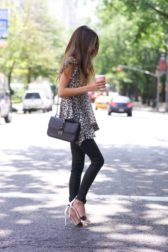 Summer is here. Out comes the animal print outfits. The leopard print looks amazing with the black skinnies and heels. ViaArielle NachamiTop: Zimmermann, Jeans: Rag & Bone, Shoes: Gianvito Rossi, Bag: Valentino
