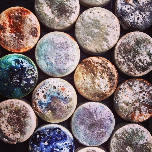 Crater glaze penny-round oxide tests. #pennyround #mosaic #handmadetiles #tiles #ceramic #stoneware #art #guymitchellart #guymitchellartist #wall #interior #original #guymitchelldesign #texture #surface