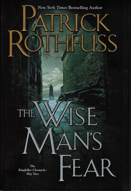 The Wise Man's Fear By Patrick RothfussReviewed by Miranda BoyerThere are a lot of things that I could say about The Wise Man's Fear by Patrick Rothfuss. Not all of which are harrowing reports. (Take that Pat!) If you've not read this book or heard of the series let me stop you for a moment and direct you towards The Name of the Wind the first in this mountain of a trilogy. Start there, it is well worth your time. As you've heard in the past, I decided to read this series after meeting Pat at ECCC this past year. He's by far the most even grounded writer I've ever met. Nice guy with good advice and more than willing to chat about books, agents, and the whole publishing world. I was very thankful. On the second night of con I went to buy some books authored by various attendees. Admittedly more than a few I'd not heard of. But what better opportunity to find new and wonderful favorites?! When I held a copies of The Name of the Wind and A Wise Man's Fear I was stopped multiple times by various patrons professing their love for the book. I knew right then I had to read them. Fast forward a few months and I've just finished with the second book in the King Killer Chronicles. I'm feeling all sorts of emotions right now. First, that sort of elated euphoria from finishing a book, the kind that comes from a truly magnificent tale. I'm feeling irritation from the way the book ended, god forbid you leave us on a happy note Pat like we're almost lead to believe. And frustration at the fact that book three doesn't even have a publication date yet! *sigh* All that aside, this was without question a brilliant follow up to the first book. I've taken some time away from my second novel, a dark fairytale, and thumbed some pages in the follow up to my first novel. There is an art to continuing a story, to keeping the heart of the first in tact. I tip my hat to Pat for he is a master story teller in every respectI fee like I don't need to tell you the details of this story. You've either read it, or are going to and in either case you don't actually want to know. You already do, or you'd like to be surprised as I was. All I'll say is that there is more of each of our favorites and many more.  I did find this fun comic online and I thought I'd share it. I don't know who the author is, but it does seem to be tagged in the corner. Without a doubt, this is not a book you want to remain in the dark about. Get on it before the rest of the commonwealth does.