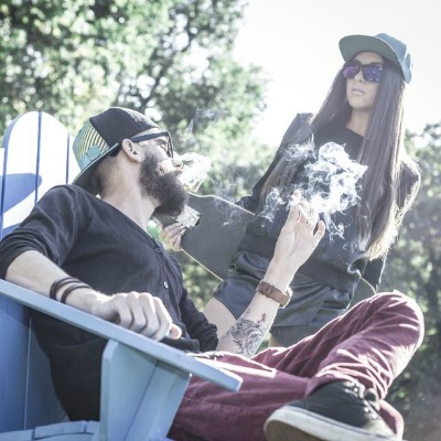 Cool Hipster Couple Smoking Cannabis Park