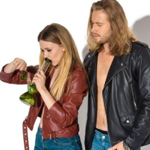 Couple Smoking Cannabis in Bong