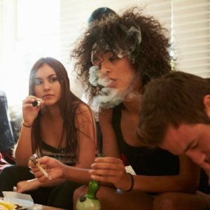 Gang Of Young People Smoking Cannabis