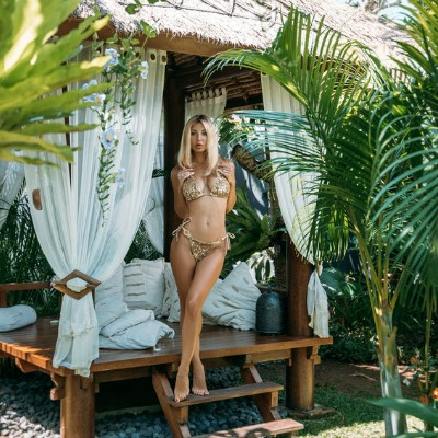 Beautiful Blonde Relaxing in Tropical Place