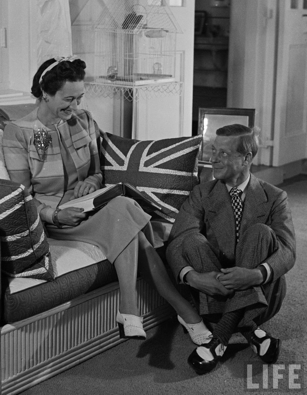 Governor of the Bahama Islands, the Duke of Windsor, smiling up at the Duchess of Windsor, as he sits at her feet in the Government House.  The Bahamas 1941.