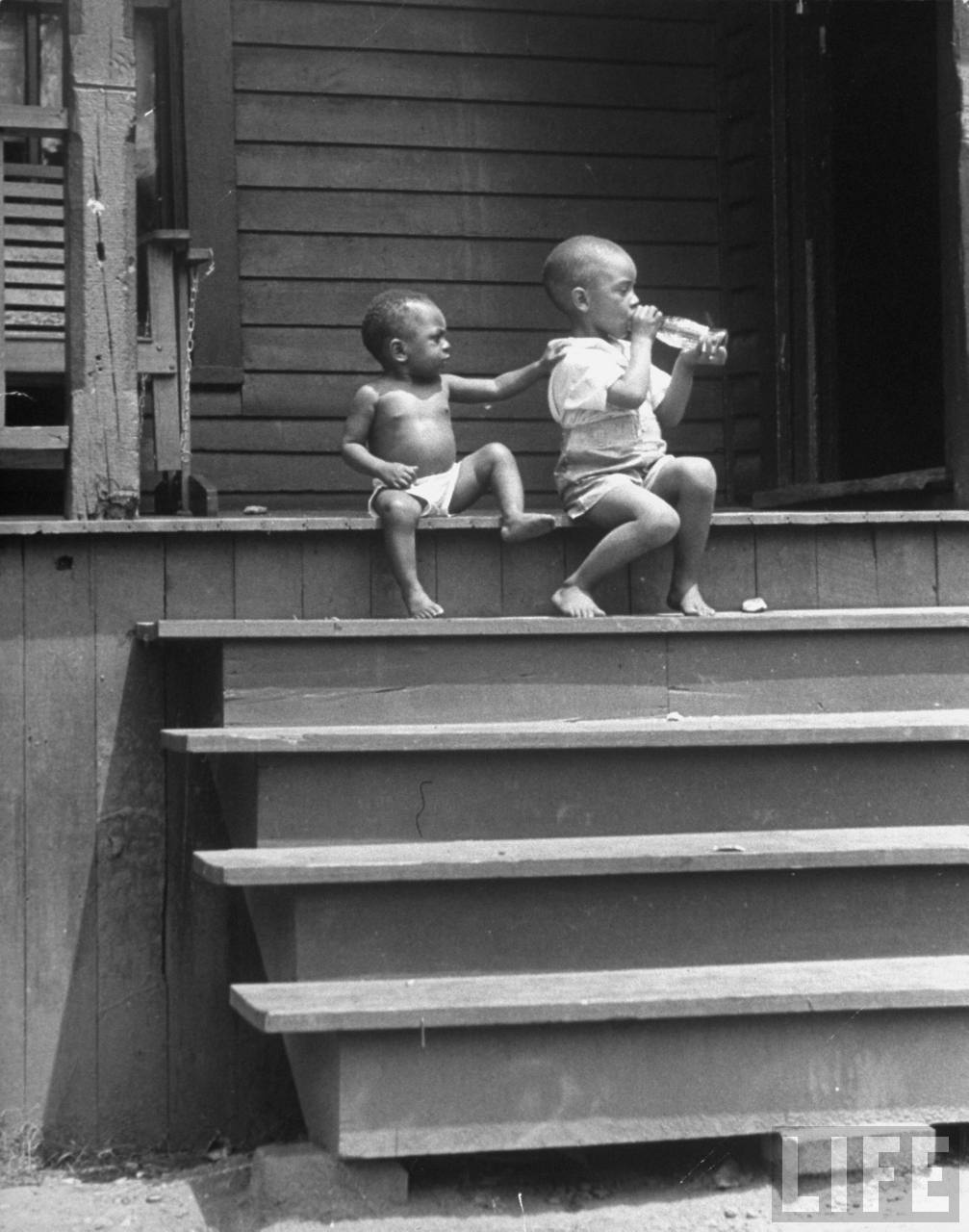 two boys with soda