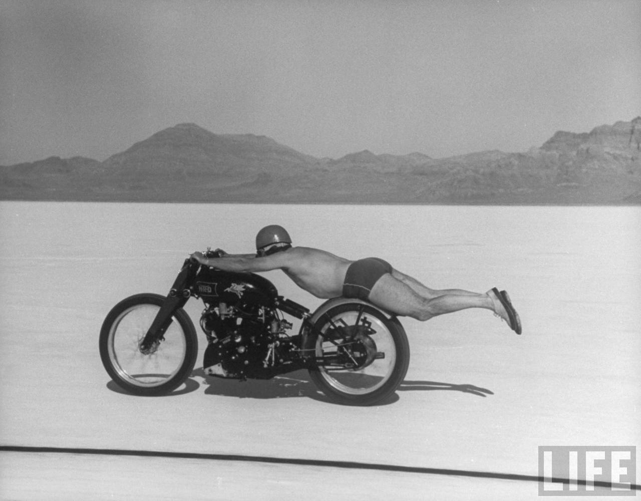 Roland Free breaking world's speed record on Bonneville Salt Flats while laying on his bike  --September, 1948.