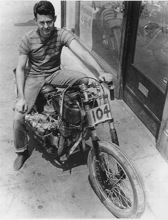 """Max Bubeck sitting on his 135.58mph hybrid Indian Chief/Scout that he rode at Rosamond Dry Lake on June 27th, 1948.  The Pop Shunk-built """"Chout"""" is as lean and mean as a straight razor except for two big-assed carburetors that look big enough to pluck poultry. Bubeck's """"Chout"""" still holds the record for the world's fastest unfaired Indian motorcycle."""