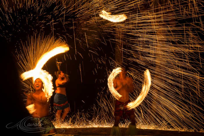people spinning fire poi in fiji