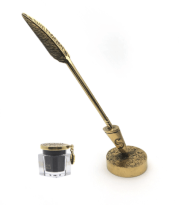 Gold feather quill liquid eyeliner brush with metallic ink pot with black eyeliner and stand with tin case.