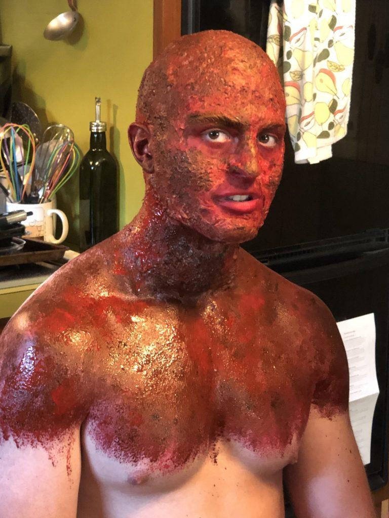 David O'bar getting into his SFX burn makeup