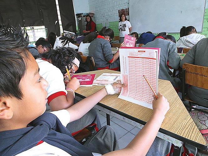 Los niños librarán este año la prueba ENLACE, pues según las autoridades del INEE no existen las condiciones para aplicar la evaluación, señala Mexicanos Primero. Foto: Mateo Reyes